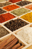 Spices variation. Wooden box with different herbs and spices - pepper, paprika, cumin and others Stock Photo
