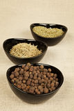 Spices variation. Spices collection in black bowls on brown background. Pepper corns, marjoram and rosemary Stock Photo