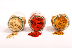 Spices. Variety of spices in a glass pot, focus in the back Royalty Free Stock Images