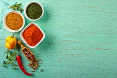 Spices. Various colorful dry and fresh spices on blue wooden background Royalty Free Stock Photos
