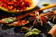 Spices. Various Indian spices on black stone table. Spice and herbs on slate background stock photography