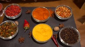 Spices. Various Indian Spices on table. different spice and herbs background, Assortment of Seasonings condiments. Spices. Various Indian Spices on table stock video