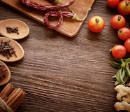 Spices and vegetables in anticipation of cooking on a wooden tab Royalty Free Stock Photography