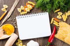 Spices and vegetables around notebook Royalty Free Stock Image