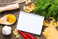 Spices and vegetables around notebook Stock Photo