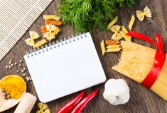 Spices and vegetables around notebook Royalty Free Stock Photo