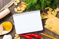 Spices and vegetables around notebook Royalty Free Stock Photography