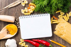 Spices and vegetables around notebook Stock Photography