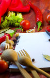 Spices, vegetables, and a notebook Stock Image