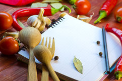 Spices, vegetables, and a notebook Royalty Free Stock Photo