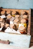 Spices in vintage bottles. Inside rustic box shelf Royalty Free Stock Photography