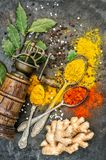 Spices vintage mill Curry powder turmeric ginger bay leaf Stock Photo