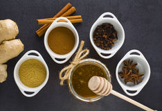 Spices. In whiete vessel and jar of honey Royalty Free Stock Photos