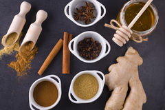 Spices. In whiete vessel and jar of honey Stock Photo