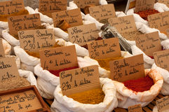 Spices. In white sacks for sale in a french market Royalty Free Stock Photos