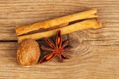 Spices on wood. Cinnamon, nutmeg and star anise on old weathered wood stock photo