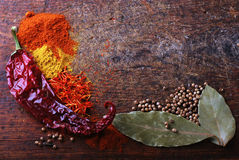 Spices on wood cutting board Royalty Free Stock Photos