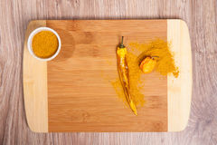 Spices on wood cutting board whit hot chili and Habanero. Culinary composition on wood table background in kitchen. Glass bowl wit Royalty Free Stock Image