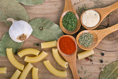 Spices on Wood table food preparation Food Stock Image