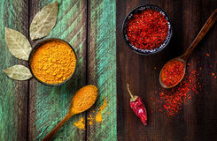 Spices on wooden background Royalty Free Stock Images