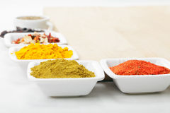 Spices at wooden board Royalty Free Stock Image