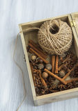 Spices in wooden box with cinnamon sticks,anise,nutmeg and jute Stock Photography