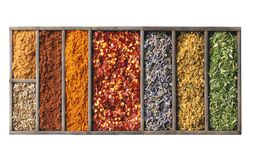 Spices in wooden box isolated Stock Photo