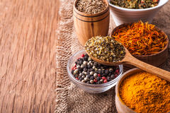 Spices in a wooden and glass bowls Royalty Free Stock Images