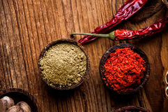 Spices in wooden Indonesian bowls Royalty Free Stock Image