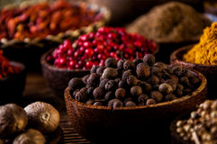 Spices in wooden Indonesian bowls Royalty Free Stock Photography