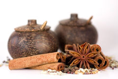 Spices & wooden jars Stock Images