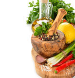 Spices, wooden mortar and vegetables Stock Photos