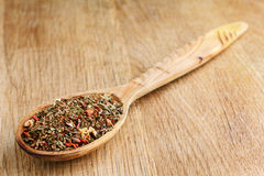 Spices in wooden spoon stock images