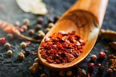 Spices in wooden spoon. Various Indian spices on black stone table. Spice and herbs on slate background. Cooking. Ingredients stock image