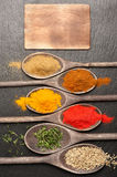 Spices in wooden spoons with space for text Royalty Free Stock Image