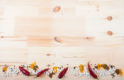 Spices on a wooden table Royalty Free Stock Photos
