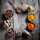 Spices at wooden table Royalty Free Stock Image