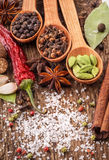 Spices on wooden table Royalty Free Stock Photo