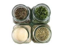 Spicy. Variation of spices in glass containers stock photos