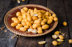 Spicy almonds in salted glaze - arabic delicious snack. Ramadan food. Selective focus. Wooden background Royalty Free Stock Images