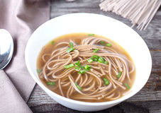 Spicy asian soup with soba noodles Stock Photography