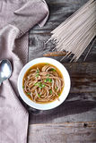 Spicy asian soup with soba noodles Stock Image