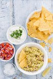 Spicy avocado sauce and assorted sauces with corn chips Stock Photo