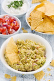 spicy avocado sauce and assorted sauces with corn chips Stock Photos