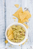 spicy avocado sauce and corn chips on white wooden background Royalty Free Stock Photos