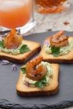 Spicy Avocado Shrimps Toasts Stock Photo