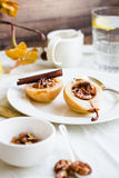 Spicy baked pear with walnuts, honey, healthy dessert,selective Stock Image