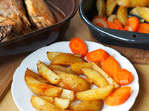 Spicy baked potatoes and turkey meat. Home-made food - baked potatoes with carrots and poultry meat Stock Photos