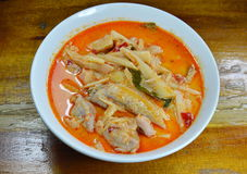Spicy bamboo shoot with chicken in coconut cream and red curry on bowl Stock Image