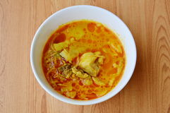 Spicy bamboo shoot with chicken in coconut cream and red curry on bowl Stock Photography